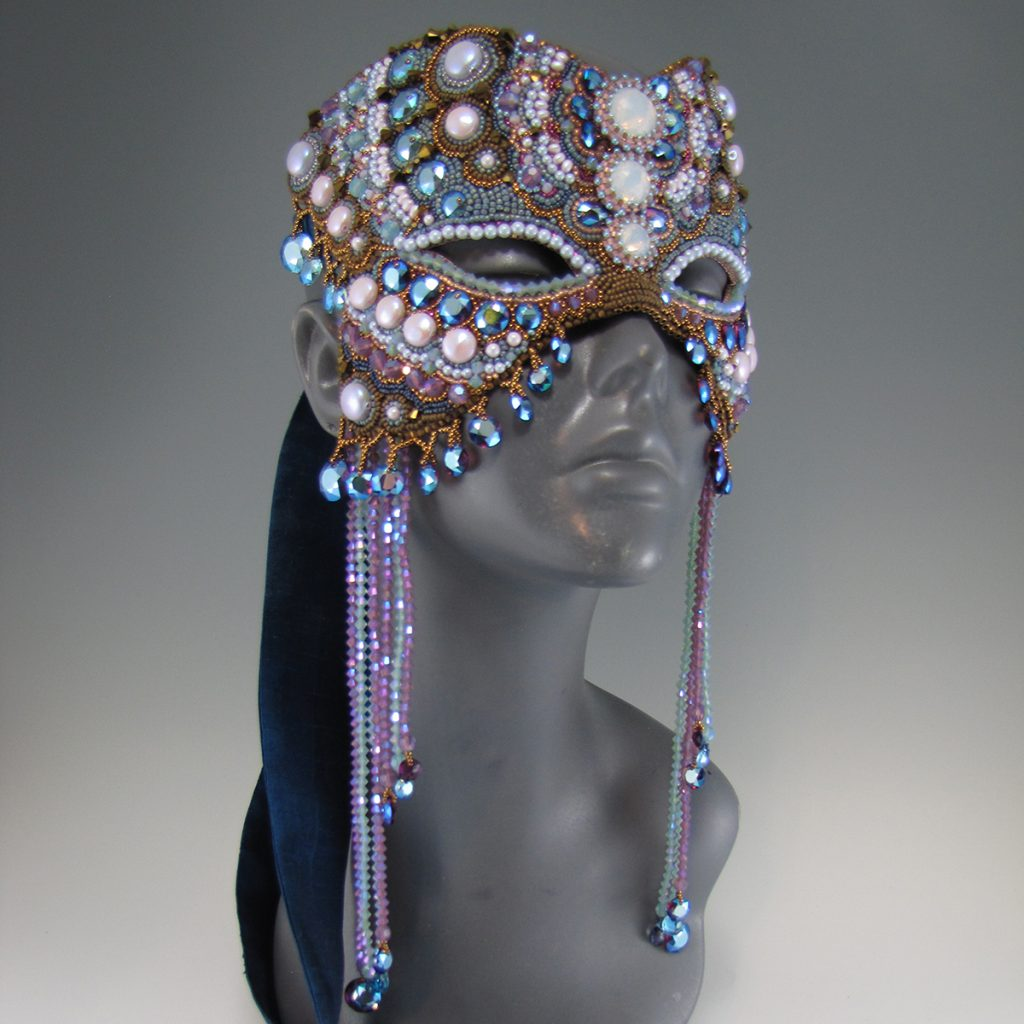 photograph of Dream of Flight beaded mask by Melissa Grakowsky Shippee